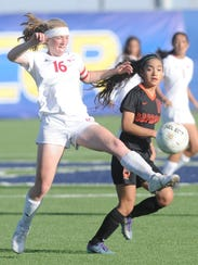 Cooper's Caylee Collier (16) kicks the ball as an Amarillo
