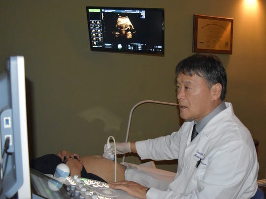 Dr. Greigh Hirata, maternal fetal medicine specialist, conducts a fetal echocardiogram on a patient at Dr. Shieh's Clinic in Tamuning on June 12, 2017.