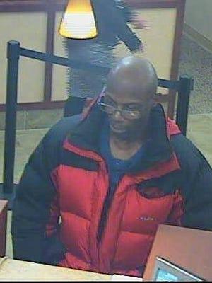 Surveillance footage shows an alleged bank robber in Brighton in December.