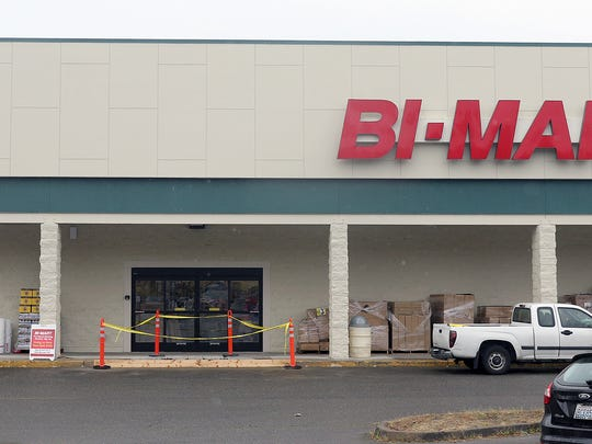 Customers sign up for membership cards at the new Bi-Mart store location on Olney and Mill Hill Drive in Port Orchard on Friday. The store is a membership discount store in Washington, Oregon, and Idaho.