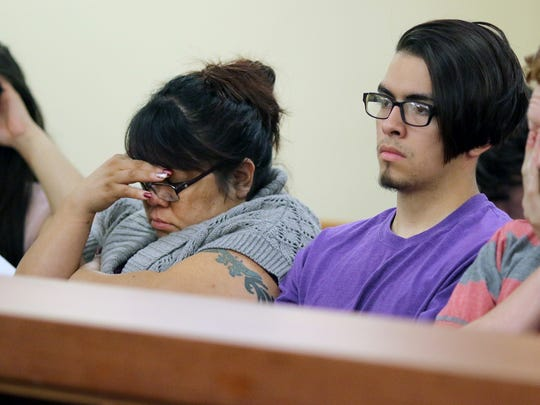 Denise Wright, center, sits with family and friends during the sentencing of Gabriel Gaeta for killing her 6-year-old daughter, Jenise Wright.