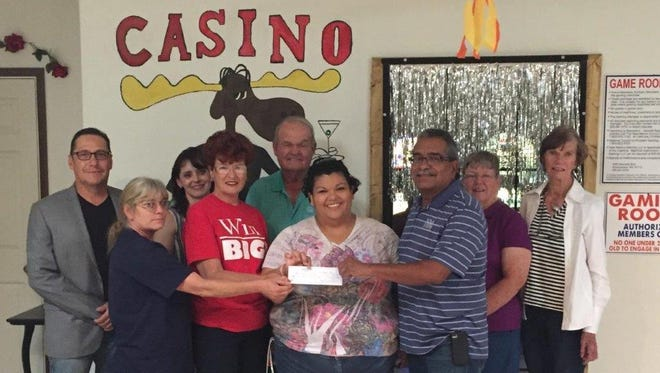 The Cancer Support of Deming and Luna County, Inc. received a check for $5,000 from the Loyal Order of Moose, Lodge 2088 and its Bowinkle Casino. Pictured at left, from the back row, are: Cancer support board members Ray Trejo, Michele Mooradian, Don Hill. Ann Chrestman and Betty Hyatt. In front, from left, representing the Bowinkle Casino are Tiny Johnson and Glenna Dandois; patient advocate Joanna Costilla and  Moose member Jerry Rivera.