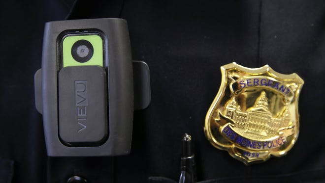 A body camera and badge worn by a Des Moines police officer.