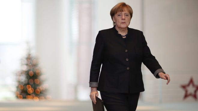 German Chancellor Angela Merkel arrives to give a statement about the suspected Christmas market attack with a truck in Berlin, at the federal chancellery, on Dec. 20.