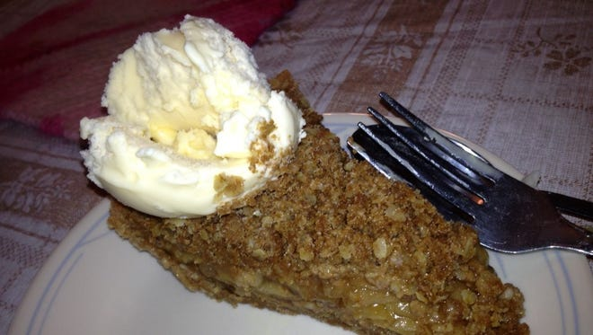 There are many variations of Dutch Apple Pie among the Amish; this one is served with a scoop of ice cream, Gloria's with a glaze.