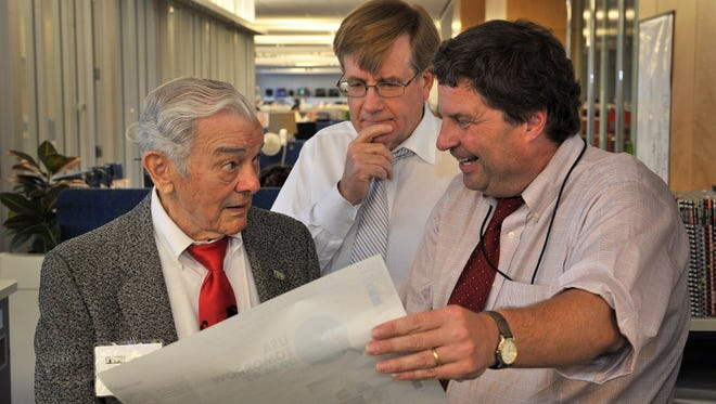 From left, USA TODAY founder Al Neuharth, editorial page editor Brian Gallagher and editor in chief David Callaway in McLean, Va., on Sept. 12, 2012.