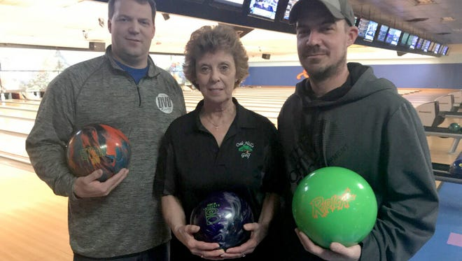 Donna Ross, along with her two sons, Jeff (left) and Brad (right), and her late husband, Paul, have bowled a total of 41 perfect 300 games. Donna has three, Jeff has 32, Brad has four and Paul had two.