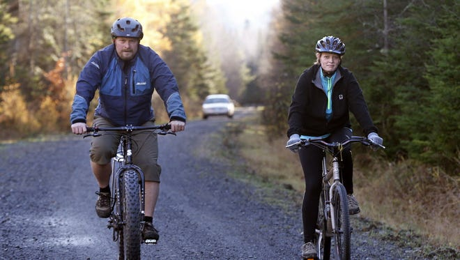 Nurse Kaci Hickox goes biking with boyfriend Ted Wilbur, followed by a Maine State trooper, in Fort Kent, Maine, on Thursday.