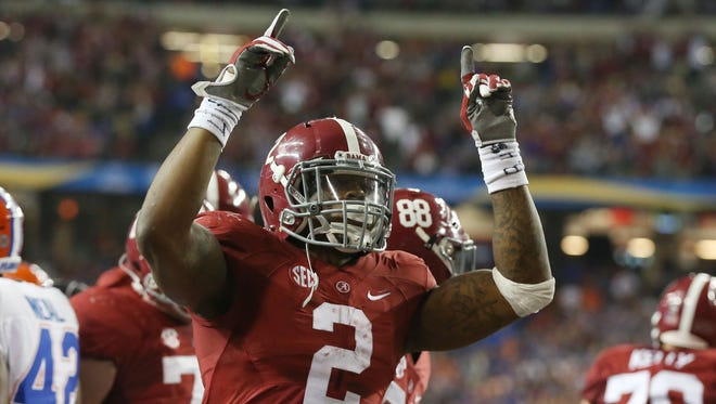 Alabama Crimson Tide running back Derrick Henry (2) celebrates his 2 yard touchdown run in the second quarter against the Florida Gators in the 2015 SEC Championship Game at the Georgia Dome.