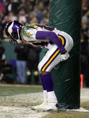 Vikings receiver Randy Moss moons the crowd after scoring a touchdown during the fourth  quarter of their playoff game against the Packers on January 9, 2005, at Lambeau Field.