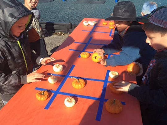 Pumpkin tic tac toe was among the games played at UES.