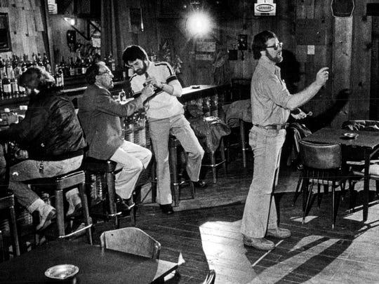 Aug. 23, 1980: New Irish Inn Dart Team, inside the inn, at Charlotte.