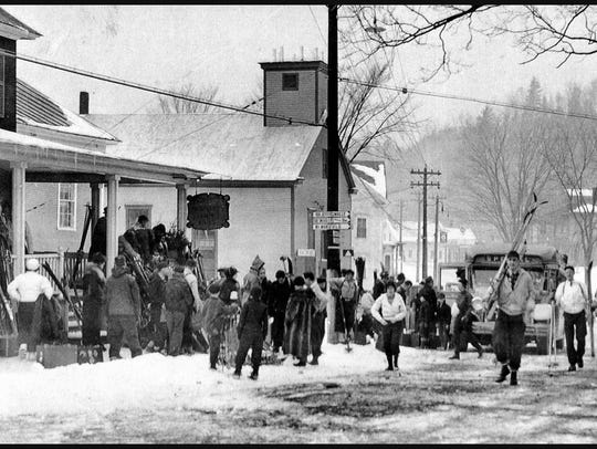 Skiers unload by the Town Meeting House in this 1940s