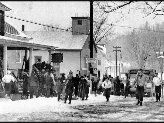 Skiers unload by the Town Meeting House in this 1940s photo. The building now houses the Vermont Ski and Snowboard Museum.