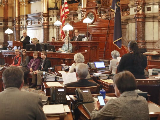 In this March 28, 2017 file photo, the Kansas Senate votes to expand KanCare, the state's Medicaid program. The Trump administration's embrace of work requirements for low-income people on Medicaid is prompting lawmakers in some conservative holdout states to reconsider expanding the program. (Thad Allton /The Topeka Capital-Journal via AP)