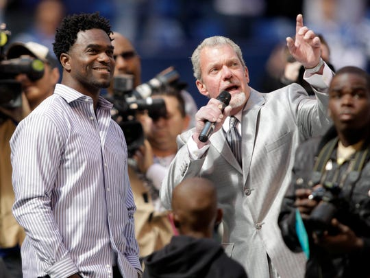 Indianapolis Colts owners Jim Irsay points to where former Colts running back Edgerrin James's name was added to the team's Ring of Honor during an NFL football game between the Indianapolis Colts and the Jacksonville Jaguars n Indianapolis, Sunday, Sept. 23, 2012.