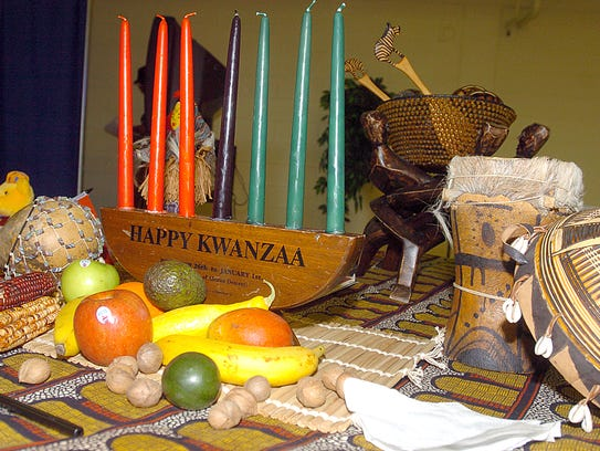 Symbols of Kwanzaa lay on a table at the T.R. White