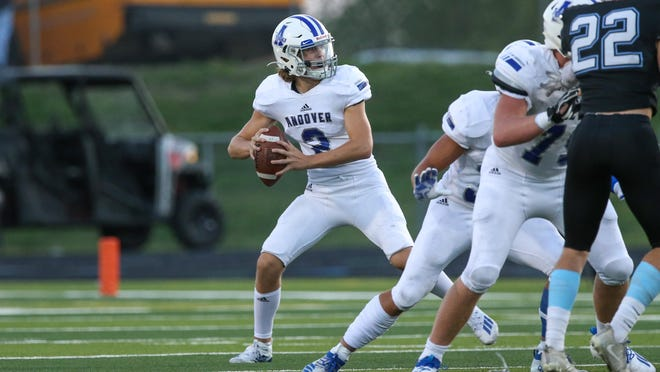 Andover's quarterback, Brady Strausz (2), drops back to pass on Friday, Sept. 25 at Goddard District Stadium. The Sophomore went 11-of-25 for 162 yards in the loss