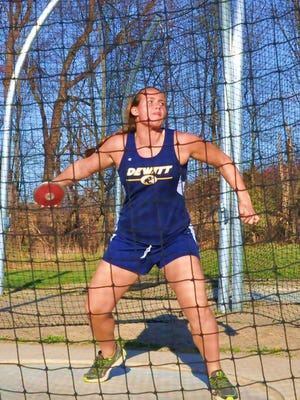 DeWitt senior Abby Nakfoor, who is in her first season competing in track and field, has set school records in the shot put and discus.