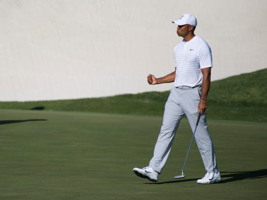 Tiger Woods pumps his fist after his eagle on 13 during