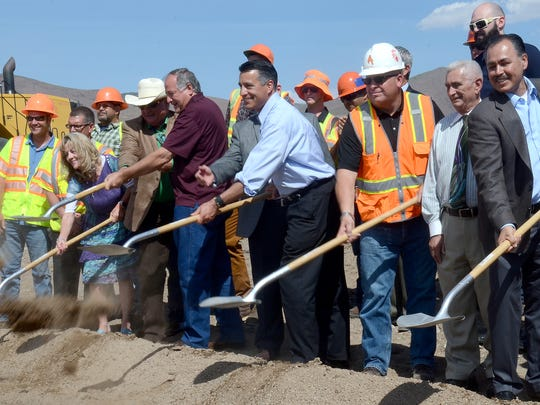 Gov. Brian Sandoval, Ames Construction workers and officials with the Nevada Department of Transportation shovel dirt as part of a groundbreaking ceremony celebrating the start of the USA Parkway construction that will extend the roadway and connect Interstate 80 to U.S. 50.