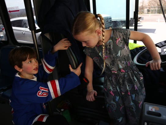 Six-year-old Vivian Keeshan (right) switches seats
