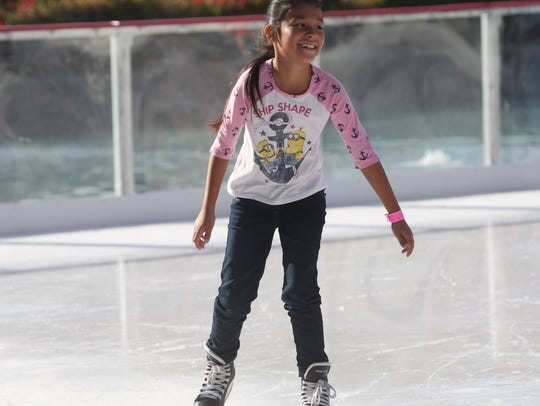 Nayeli Gonzalez, 8, of Coachella enjoys a day at skating on ice at The River in Rancho Mirage on Nov. 23, 2017.  