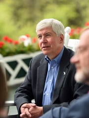 Gov. Snyder talks to media on the porch of the Grand Hotel after the closing session of the 2015 Mackinac Policy Conference on Friday May 29, 2015 at Mackinac Island, Mich.