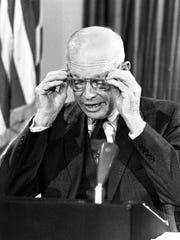 U.S. President Dwight Eisenhower reads from his notes