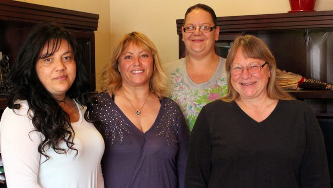 From left are Delilah Segarra, Veronika Molina, Melissa Downey and Susie Eaton of Southwestern Regional Housing and Community Development.