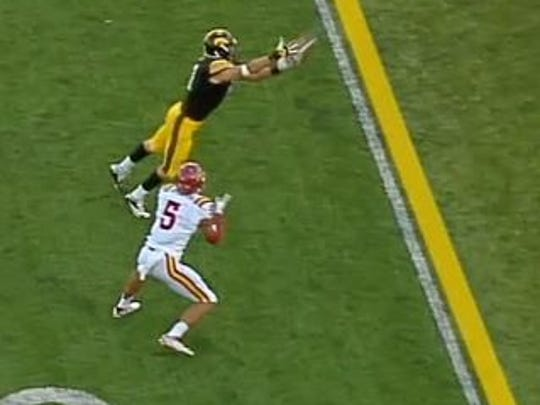 On this screen grab, Iowa's Bo Bower has the football