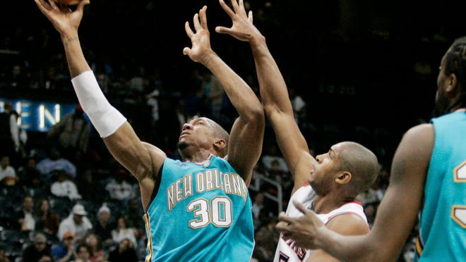 David West (30) and the New Orleans Hornets played a role in the city's recovery following Hurricane Katrina.