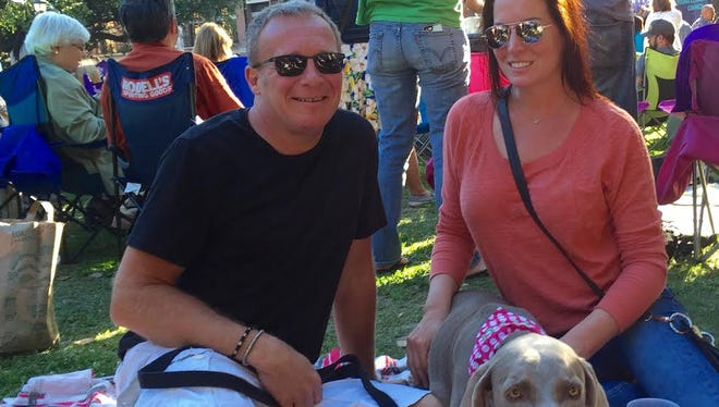 Kent Broussard, left, and Julie Egren often attend festivals with their dog, Ava. Broussard and Egren are now planning an event of their own, the NOLA Mac 'N' Cheese Fest.