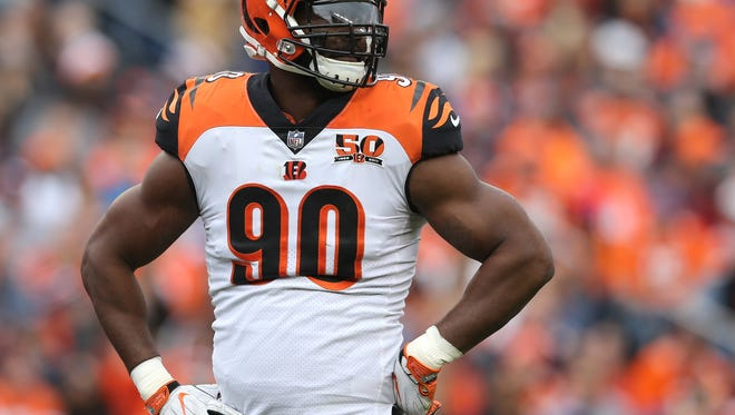 Cincinnati Bengals defensive end Michael Johnson (90) looks toward the bench in the first quarter during the Week 11 NFL game between the Cincinnati Bengals and the Denver Broncos, Sunday, Nov. 19, 2017, at Sports Authority Field at Mile High in Denver, Colorado.