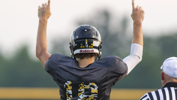 Avon High School junior Brandon Peters (18) reacts after completing a 80-yard touchdown during the second half of action. Avon High School hosted Ben Davis High School in varsity football Friday, August 29, 2014. Ben Davis defeated Avon 57-27.