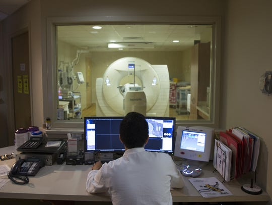 A medicine tech makes a PET scan of a patient at Georgetown