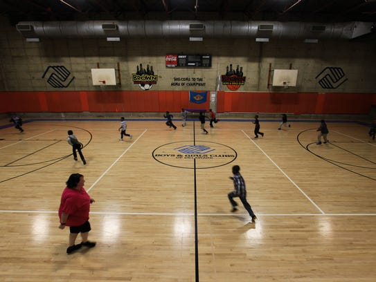 Children play on a new basketball court at the H. Fletcher