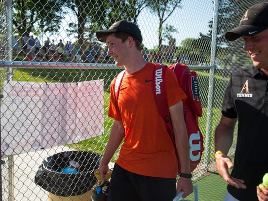 Ames High's Timmy Ellis smiles while walking off the