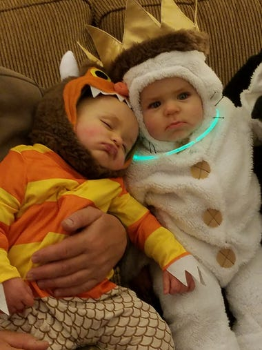 One-year-old twins Jacob and Mason dress as Carol and