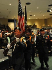 Hmong veterans perform the color guard and national