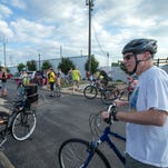 Bicyclist fans gather at Mahoney's to begin their 5-mile group ride in the 3rd annual Slow Roll Oshkosh on Tuesday, July 19, 2016.