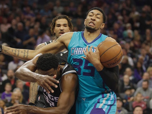 Charlotte Hornets forward Christian Wood, right, pulls a rebound away from Sacramento Kings guard Tyreke Evans during the first half of an NBA basketball game Saturday, Feb. 25, 2017, in Sacramento, Calif. (AP Photo/Rich Pedroncelli)