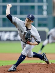 New York Yankees starting pitcher Sonny Gray throws against the Houston Astros during the first inning of a baseball game Monday, April 30, 2018, in Houston.