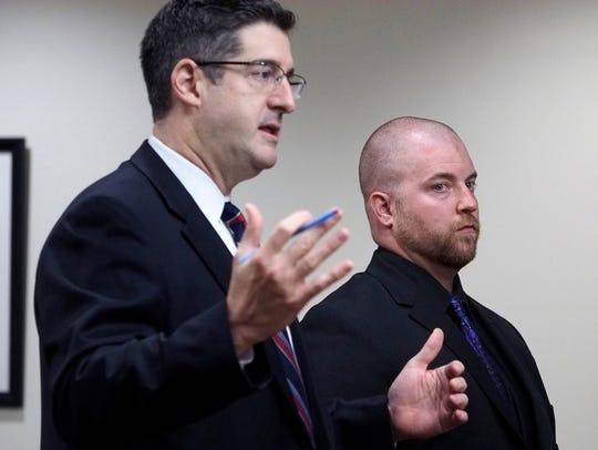 Defense attorney Charles Sciarra (left) speaks on behalf