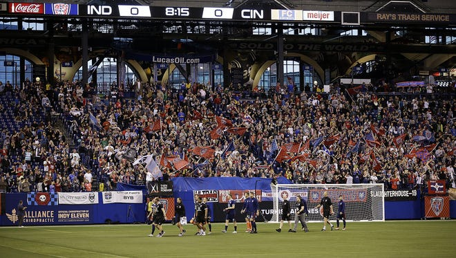 The Indy Eleven players take to the field for their game against FC Cincinnati at Lucas Oil Stadium on Saturday, March 31, 2018.