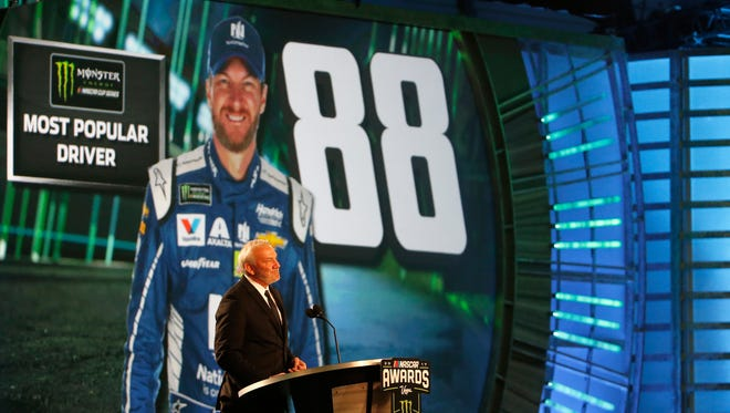 NASCAR Hall of Famer Dale Jarrett presents the Most Popular Driver award to Dale Earnhardt Jr., who won for the 15th consecutive year.