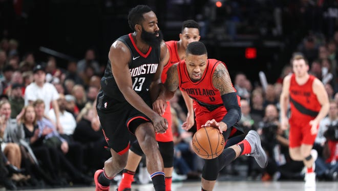 Houston Rockets guard James Harden defends against Portland Trail Blazers guard Damian Lillard in the second half at Moda Center.