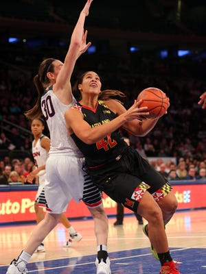 Maryland Terrapins center Brionna Jones (42) drives against Connecticut Huskies forward Breanna Stewart (30) during the fourth quarter at Madison Square Garden. Connecticut defeated Maryland 83-73.