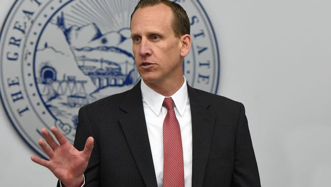 A file photo of Washoe County District Attorney Chris Hicks at a press conference. Hicks recently announced that Sparks police officers were justified in shooting and killing an armed suicidal man who reportedly pointed a rifle at police.