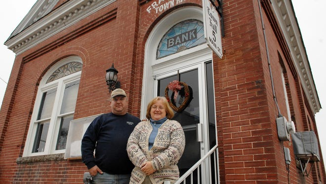 From left: Jesse Truitt, former president of the Frankford Town Council, and his wife, Terry Truitt, the former town administrator, stand in front of Town Hall in 2008.